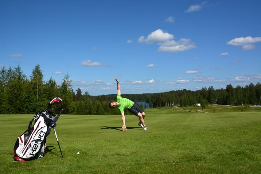 A man preparing for a cartwheel on the golf course.